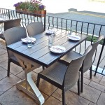 These patio dining tables feature a painted base with a stained top.